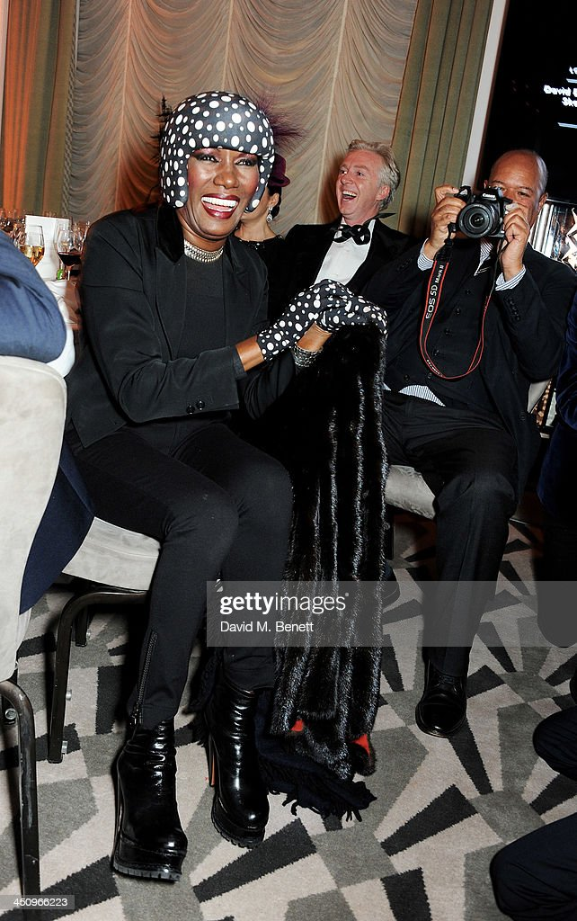 Grace Jones, Philip Treacy and Michael Roberts attend the Isabella Blow: Fashion Galore! charity dinner hosted by the Isabella Blow Foundation at Claridges Hotel on November 19, 2013 in London, England.
