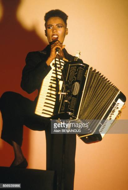 Grace Jones playing accordion on stage at Olympia music hall on December 02 1988 in Paris France