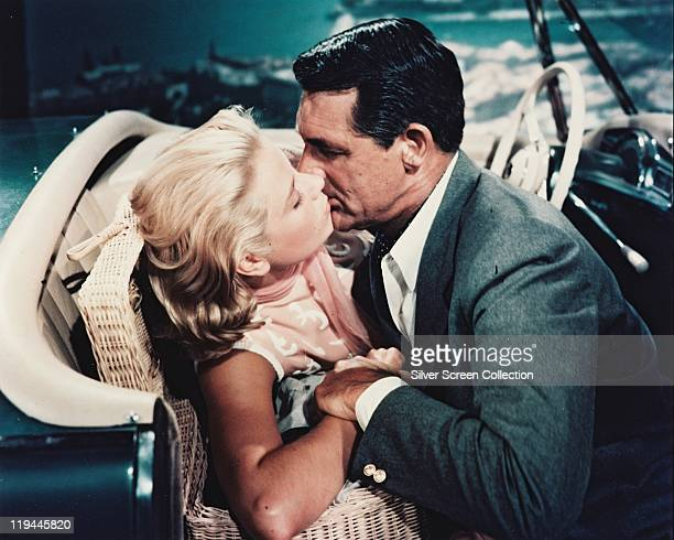 Grace Kelly and Cary Grant kissing in the front seat of a car in a publicity still issued for the film 'To Catch a Thief' 1955 The 1955 film directed...
