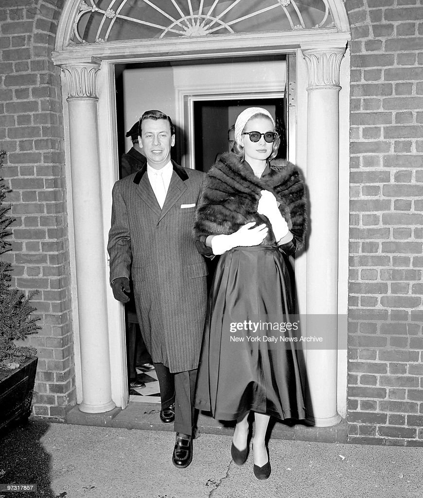 Grace Kelly, clad in a mink stole and topped off with a pink straw turban, leaves for Rita Gam wedding.