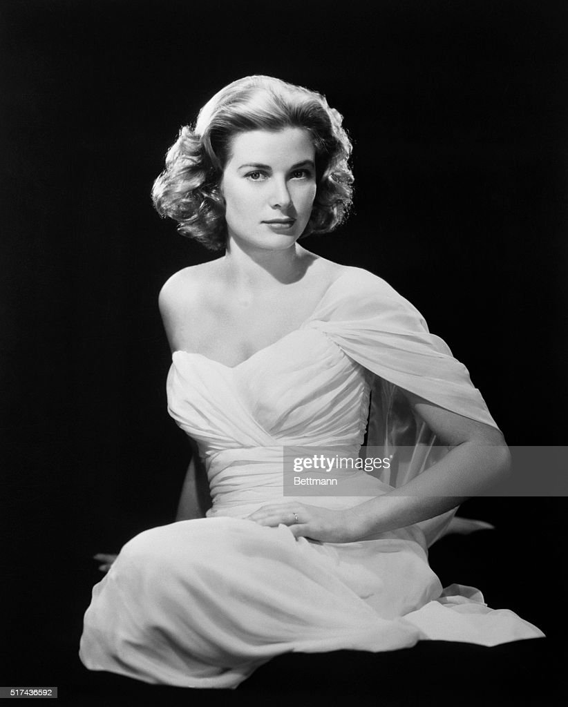 Grace Kelly, movie actress who is to become a princess next month, thinks this photograph of her is 'too sexy,' according to Paramount photographer Bud Fraker. The lensman, who has photographed Miss Kelly more than any other photographer, describes her as 'the woman with a thousand faces - all of them pure.'