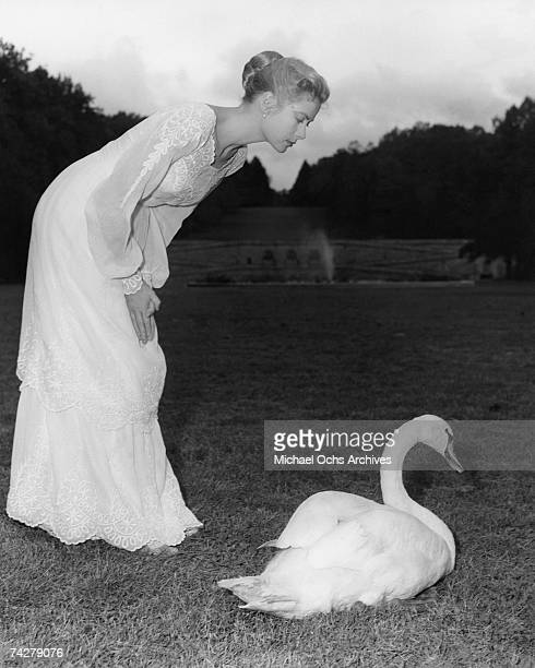 Grace Kelly poses with a swan on the set of the MGM movie titled 'The Swan' on the set at the Biltmore Estate in 1956 in Asheville North Carolina