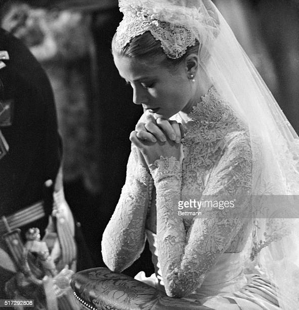 Grace Kelly prays during her wedding to Prince Rainier of Monaco on April 20 1956