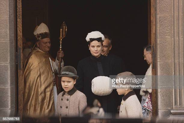 Grace Kelly Princess Grace of Monaco pictured with her husband Rainier III Prince of Monaco behind and children Caroline and Albert leaving a Mass in...