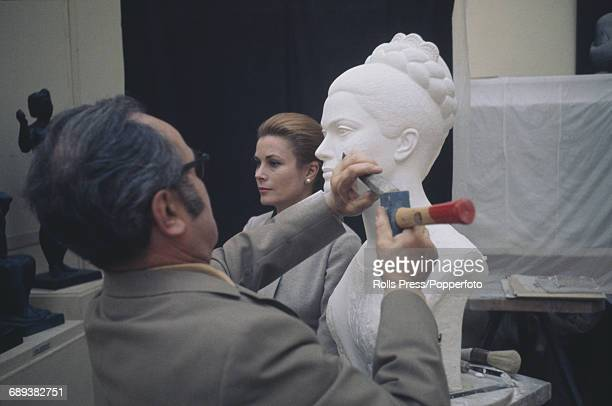 Grace Kelly Princess of Monaco poses for sculptor Lucien Gilbert as he carves a portrait bust of a likeness of the princess in his studio in Paris...