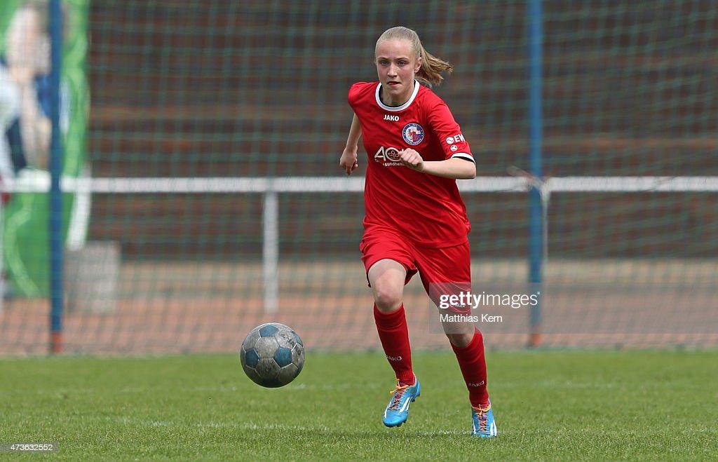 Grace Lehwald of Potsdam runs with the ball during the U17 Girl's Bundesliga semi final first leg match between Turbine Potsdam and FSV Guetersloh...