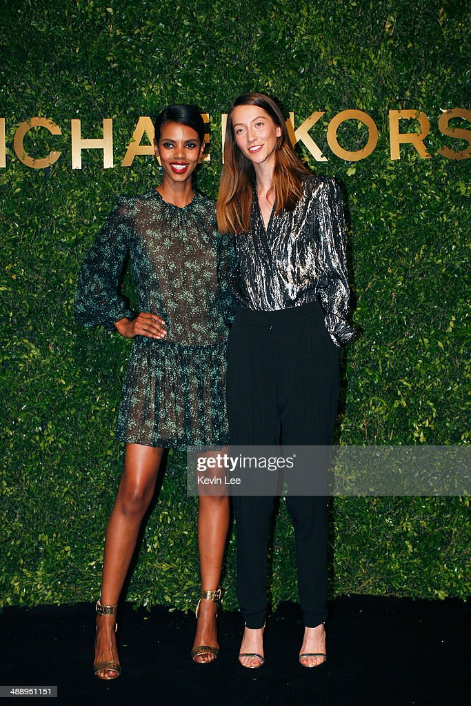 Grace Mahary and Alana Zimmer poses for a picture after the Michael Kors fashion show on May 9, 2014 in Shanghai, China.