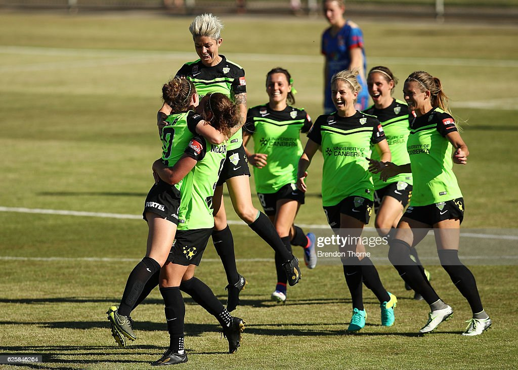 Grace Maher of Canberra celebrates with team mates after scoring a goal during the round four W-League match between Canberra United and the Newcastle Jets at McKellar Park on November 26, 2016 in Canberra, Australia.