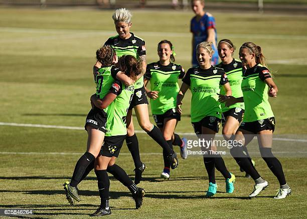 Grace Maher of Canberra celebrates with team mates after scoring a goal during the round four WLeague match between Canberra United and the Newcastle...