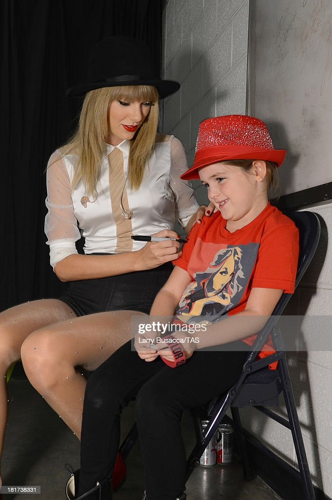 Grace Markel, 7, meets Taylor Swift backstage before the final night of three sold-out hometown shows at Nashville's Bridgestone Arena on September 21, 2013.