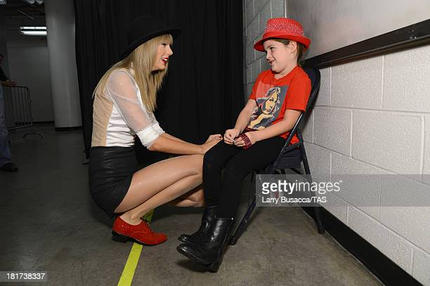 Grace Markel meets Taylor Swift backstage before the final night of three soldout hometown shows at Nashville's Bridgestone Arena on September 21 2013
