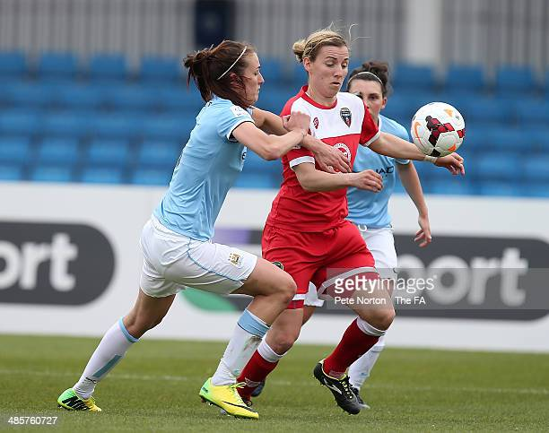 Grace McCatty of Bristol Academy Women contests the ball with Jill Scott of Manchester City Women during the FA WSL 1 match between Manchester City...