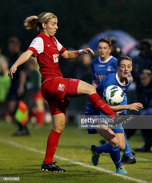 Grace McCatty of Bristol clears from Emily Westwood of Birmingham during The FA WSL match between Bristol Academy Women and Birmingham City Ladies on...
