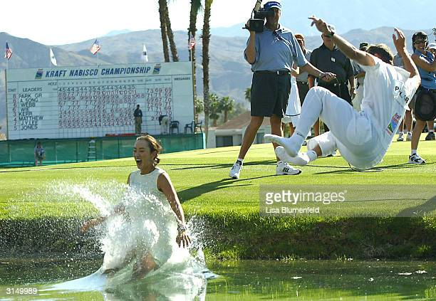 Grace Park and her caddie celebrate winning the Kraft Nabisco Championship at the Mission Hills Country Club March 28 2004 in Rancho Mirage California