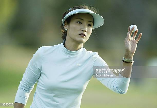 Grace Park of Korea celebrates a birdie on the 18th green and a nineunder par 61 during the third round of the Welch's/Fry's Championship at the...