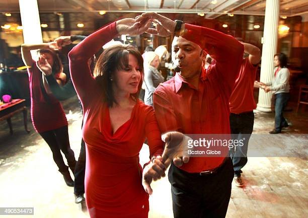 Grace Polcaro of Lynnfield and Greg Coles of Marblehead dance as Coles leads Latin dance lessons before a band played at the weekly Latin dance party...