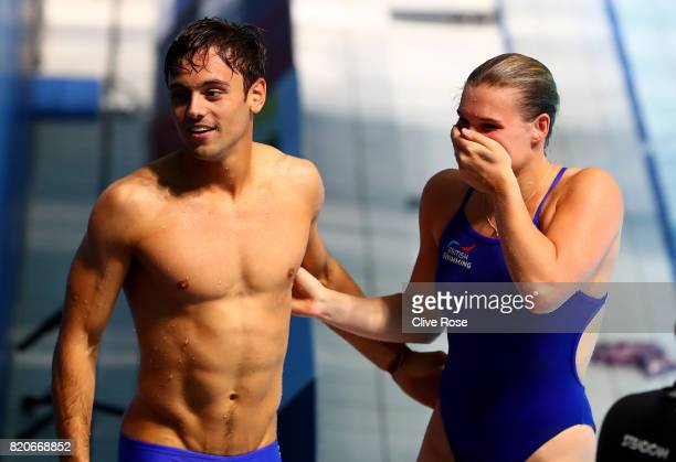 Grace Reid and Tom Daley of Great Britain celebrate after getting the silver medal in the Mixed 3M Synchro Springboard final on day nine of the...