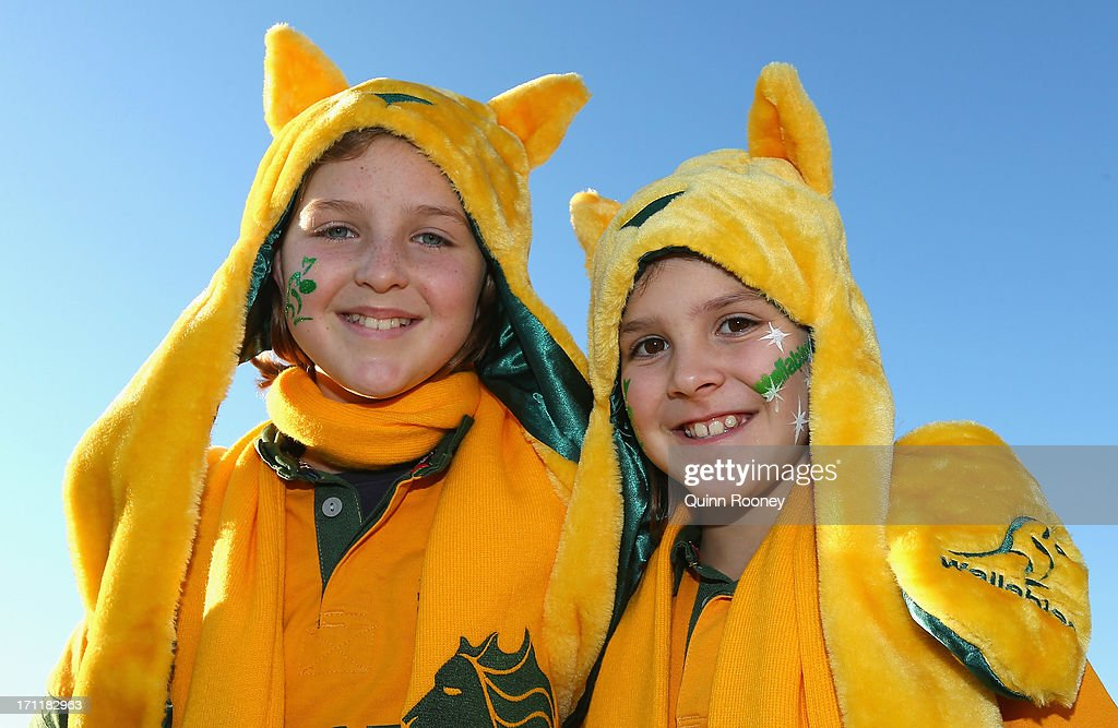 Grace Reynolds and Ella Reynolds pose during an Australian Wallabies fan day on June 23, 2013 in Melbourne, Australia.
