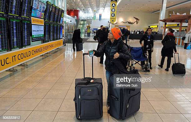Grace Sylvester looks at the departures and arrivals board near the Southwest ticketing area at the airport in Hanover Md after learning that her...