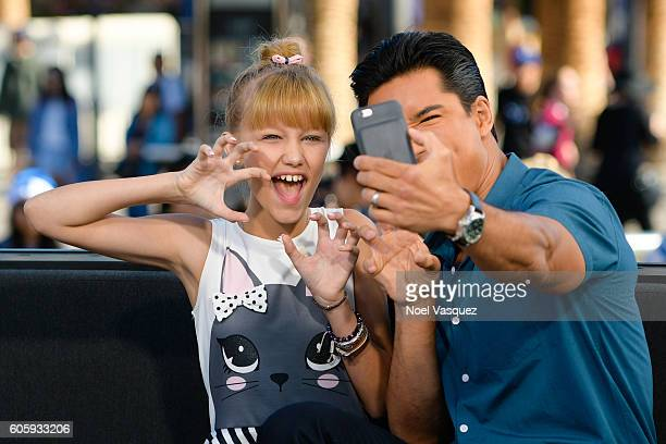 Grace Vanderwaal and Mario Lopez take a selfie together at 'Extra' at Universal Studios Hollywood on September 15 2016 in Universal City California