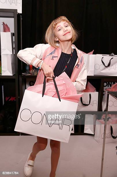 Grace VanderWaal poses with Conair Beauty products during Z100's artist gift lounge during Jingle Ball 2016 at Madison Square Garden on December 9...