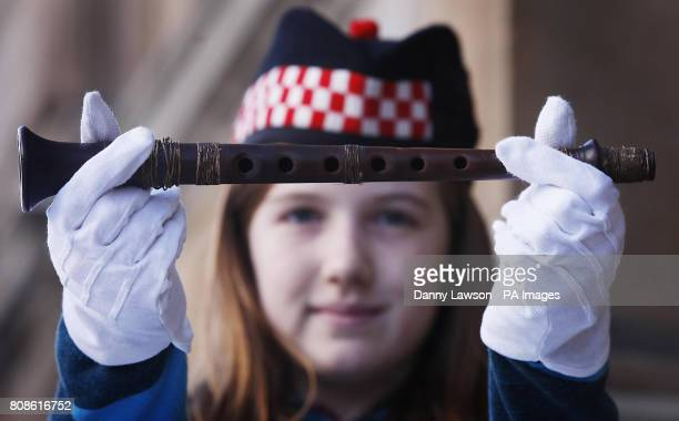Grace Welden distant relative of Iain Dall MacKay holds the oldest known Highland bagpipe chanter at its new home in the National Piping Centre in...
