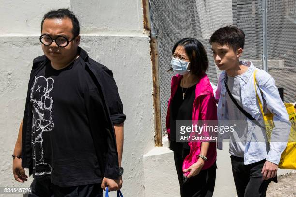 Grace Wong accommpanied by prodemocracy activist Figo Chan and Derek Lam arrive at Pik Uk Correctional Facility in Hong Kong on August 18 where her...