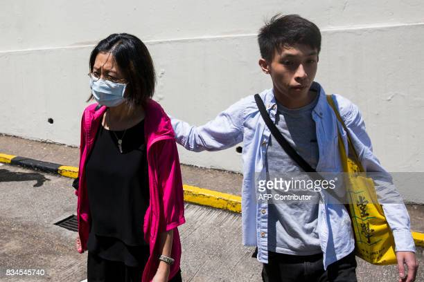 Grace Wong accommpanied by prodemocracy activist Figo Chan arrives at Pik Uk Correctional Facility in Hong Kong on August 18 where her son Joshua...