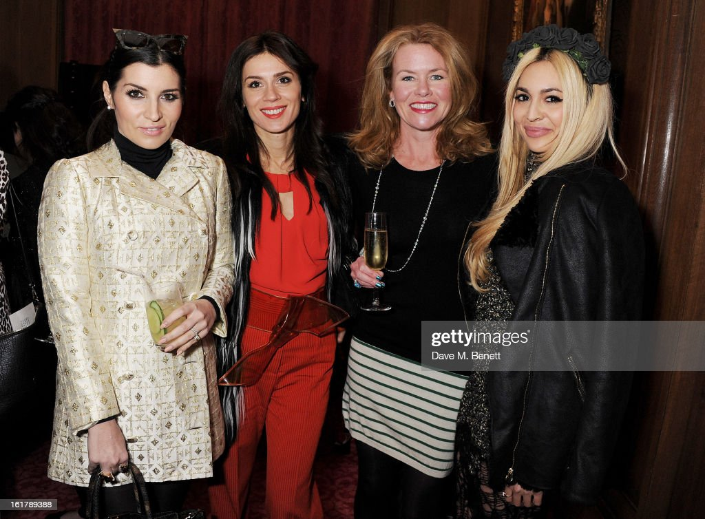 Grace Woodward, Lara Bohinc, Erin Morris and Zara Martin attend the Julien Macdonald show during London Fashion Week Fall/Winter 2013/14 at Goldsmiths' Hall on February 16, 2013 in London, England.