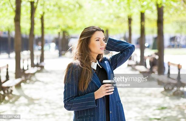Graceful Super Attractive and Fashionable Woman Walking In A Park