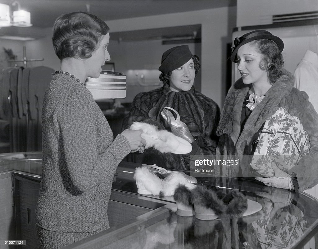 Gracie Allen shops for slippers in a Los Angeles store with fellow actress Frances Drake