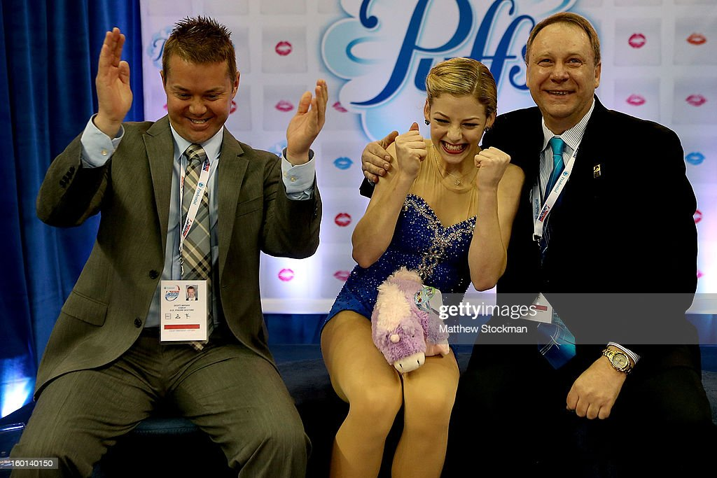 Gracie Gold reacts with her coaches, Scott Brown and Alex Ouriashev, to her score after competing in the Ladies Free Skate during the 2013 Prudential U.S. Figure Skating Championships at CenturyLink Center on January 26, 2013 in Omaha, Nebraska.