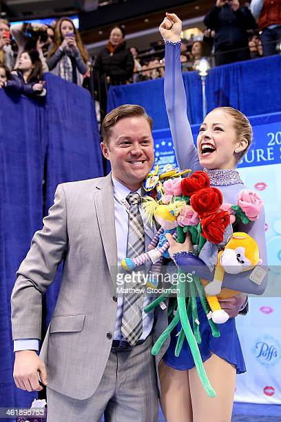 Gracie Gold with her coach Scott Brown celebrates in the kiss and cry after skating in the ladies free skate during the Prudential US Figure Skating...