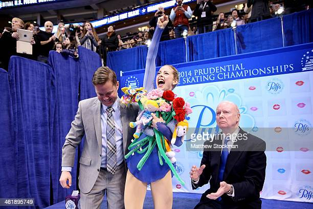 Gracie Gold with her coaches Scott Brown and Frank Carroll celebrates in the kiss and cry after skating in the ladies free skate during the...
