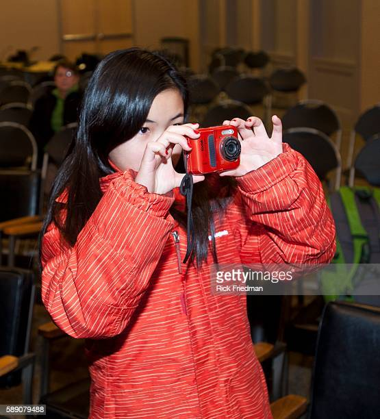 Gracie May Hunstman age 12 daughter of Republican presidential candidate Jon Huntsman taking a photograph during her father's campaign event at...