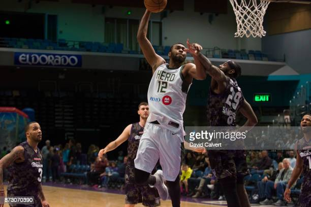 Gracin Bakumanya of the Wisconsin Herd dunks over defender JaKarr Sampson of the Reno Bighorns during an NBA GLeague game on Nov 11 2017 at the Reno...