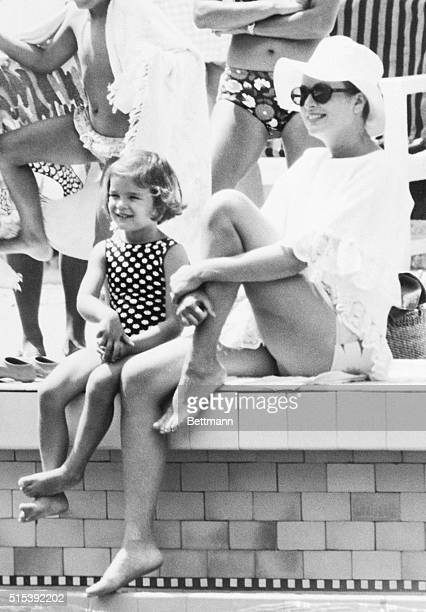 Gracing Swimmers with Her Presence Monte Carlo Princess Grace of Monaco in white beach outfit and white sun hat and her daughter Princess Stephanie...