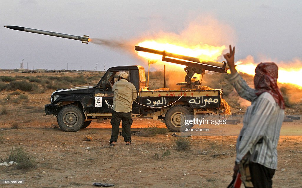 A 'Grad' rocket is launched from a home-made launcher placed on a Toyota Land Cruiser built in Misrata on October 12, 2011 in Sirte, Libya. Fighting in Libya has ceased following the killing of former leader Muammar Gaddafi and the toppling of his regime. NATO forces used new equipment during the conflict while the Libyan rebel forces utilized whatever technology was made available to them from assisting countries. The Toyota brand vehicles were actively in use particularly the outdated pickup trucks. NATO and National Transitional Council (NTC) are now supporting the collection of the abandoned weapons scattered in the desert and storehouses in Libya to avoid looting, stockpiling and exchange with guerrilla warriors and various terrorists groups from other struggling nations.