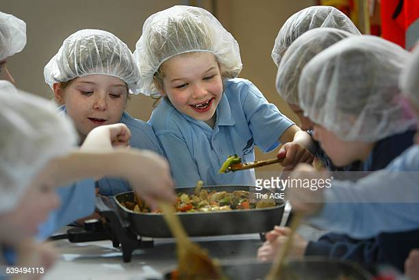 Grade 1 children from Karingal Primary school in their cooking class where they are taught the benefits of healthy eating Taken 19 August 2004 THE...