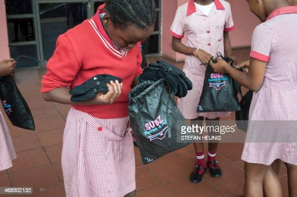 Grade 7 pupils leave with a Subz Pads Panties pack after and educational talk about menstruation and Female reproductive system on March 7 2015 at...