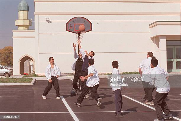 grades 9 and 10 students at the new Isna HIGH school which is part of the Isna Mosque of the Islamic Centre of Canada on enjoy a game of pickup...