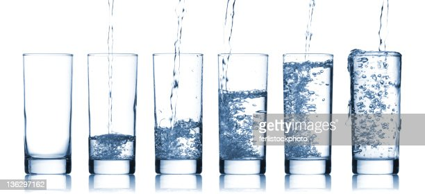 Gradually larger glasses of pure water : Stock Photo