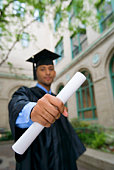 Graduate holding out diploma