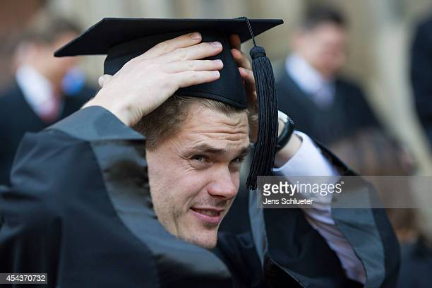 Graduate in gown and caps celebrate their graduation at the HHL Leipzig Graduate School of Management on August 30 2014 in Leipzig Germany A total of...