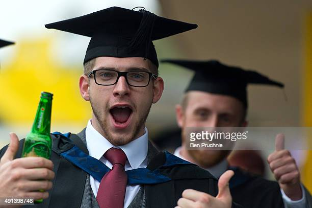 A graduate poses for photographs ahead of his graduation ceremony at the Royal Festival Hall on October 5 2015 in London England Students from London...