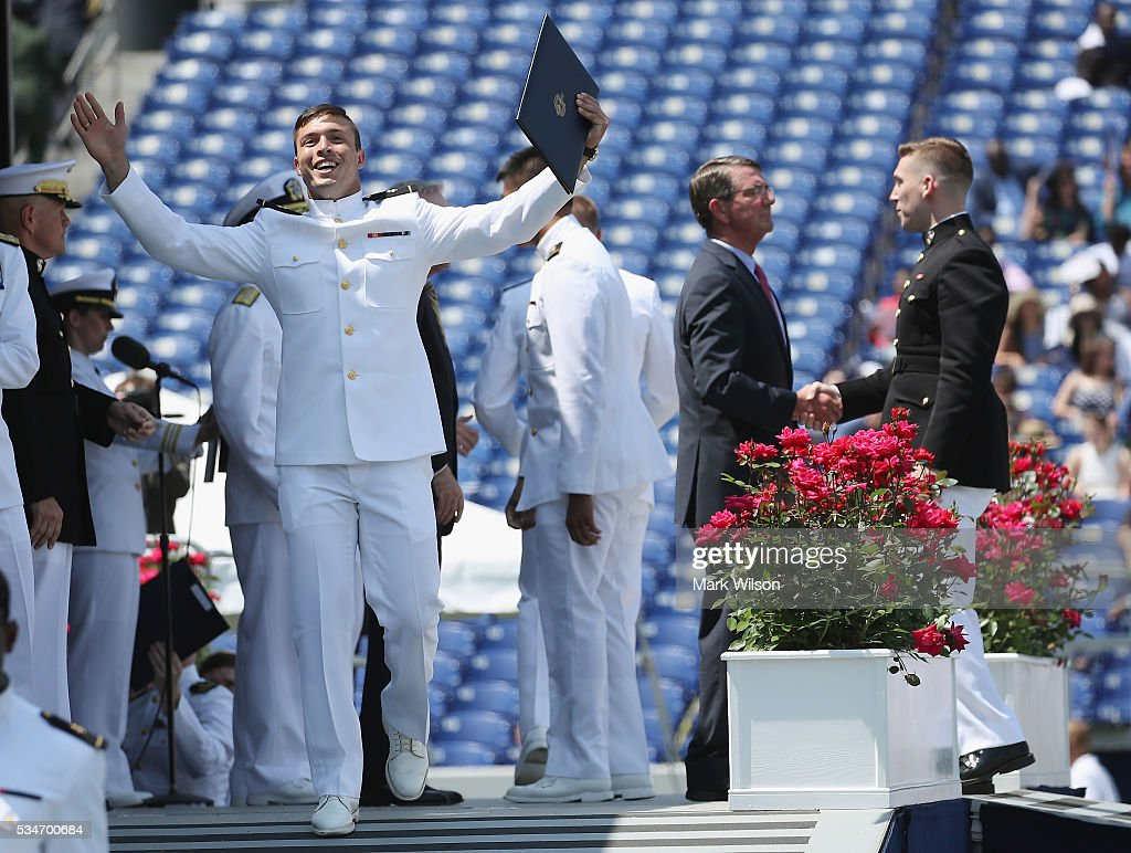 A graduate reacts as U.S. Secretary of Defense Ashton Carter (R) greets members of the class of 2016 during graduation ceremonies at the U.S. Naval Academy May 27, 2016 in Annapolis, Maryland.