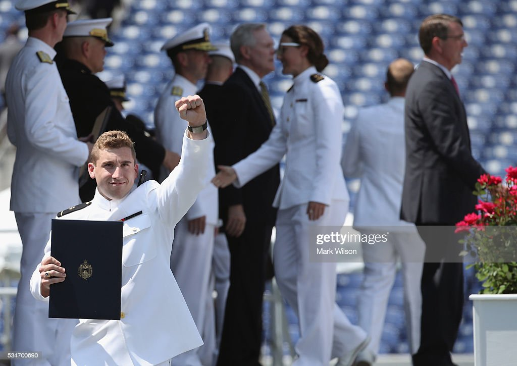 A graduate reacts as U.S. Secretary of Defense Ashton Carter (R) greets the class of 2016 during graduation ceremonies at the U.S. Naval Academy May 27, 2016 in Annapolis, Maryland.