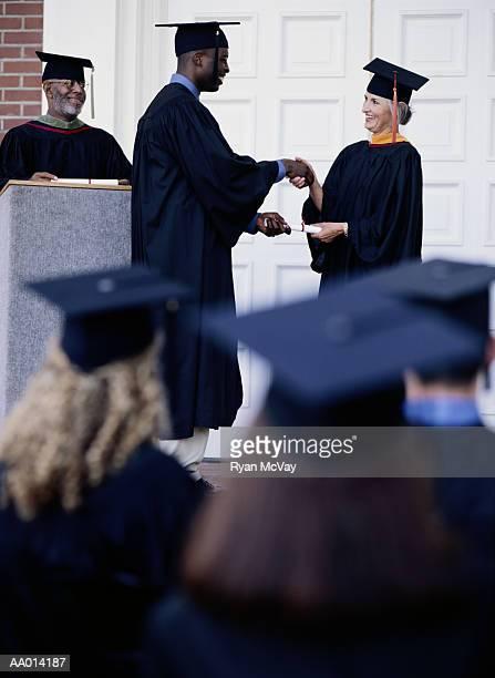 Graduate Receiving a Diploma
