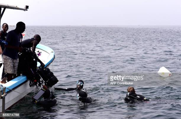 Graduate students from Dakar's Chiekh Anta Diop university end their diving following an expedition to find traces of slave shipwrecks on May 16 2017...