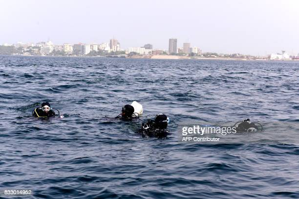Graduate students from Dakar's Chiekh Anta Diop university ready to dive during an expedition to find traces of slave shipwrecks on May 16 2017 off...